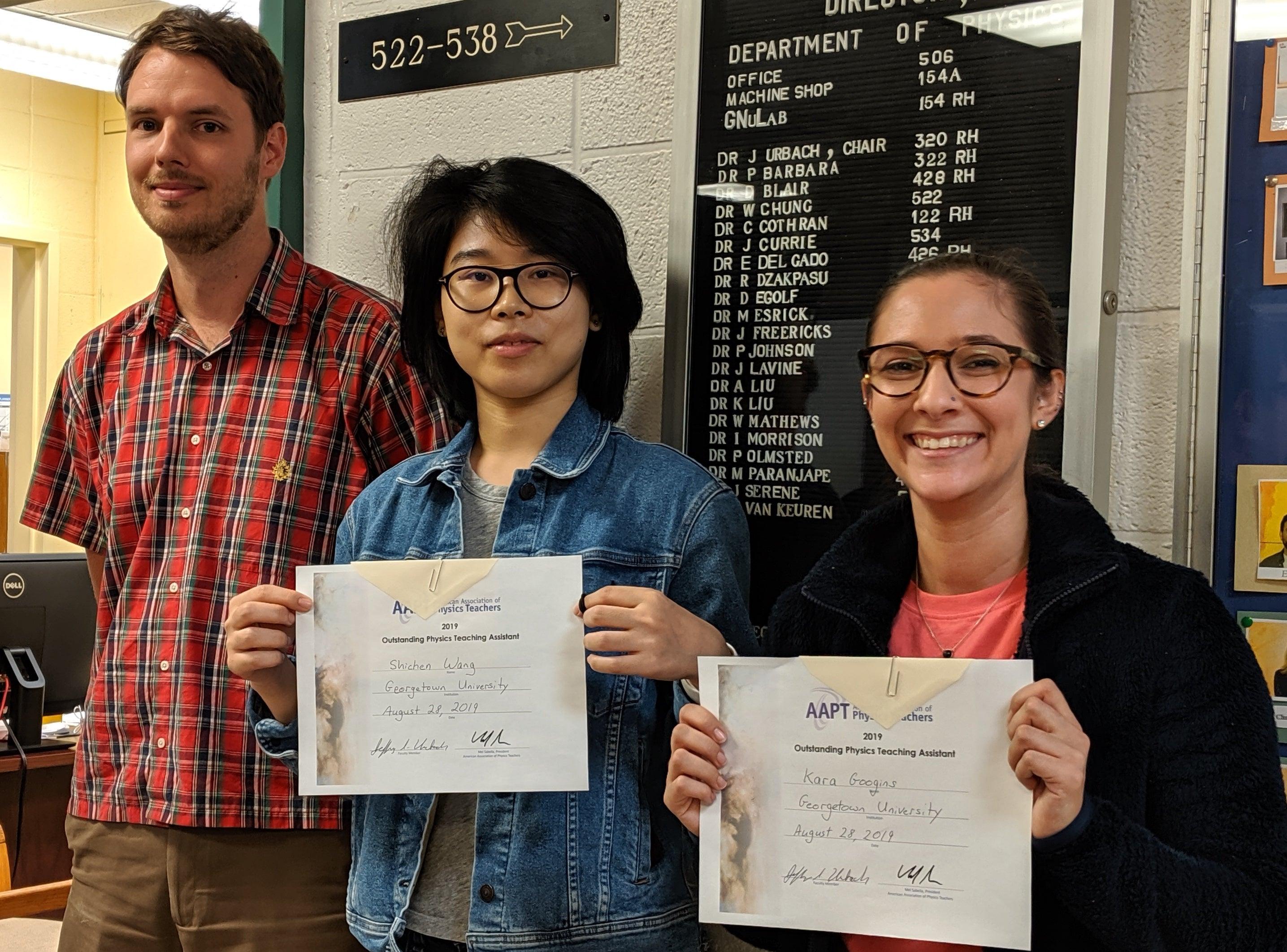 Shichen Wang and Kara Googins hold TA Awards